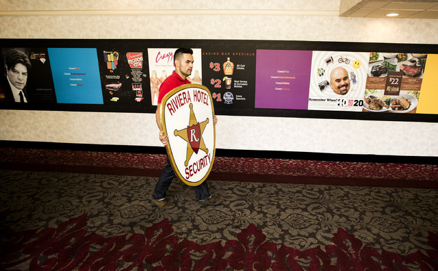 Former Riviera employee Arturo Montes carries sign he wants to purchase during the liquidation sale at the closed Riviera hotel-casino, 2901 South Las Vegas Boulevard, on Wednesday, May 13, 2015.F ...