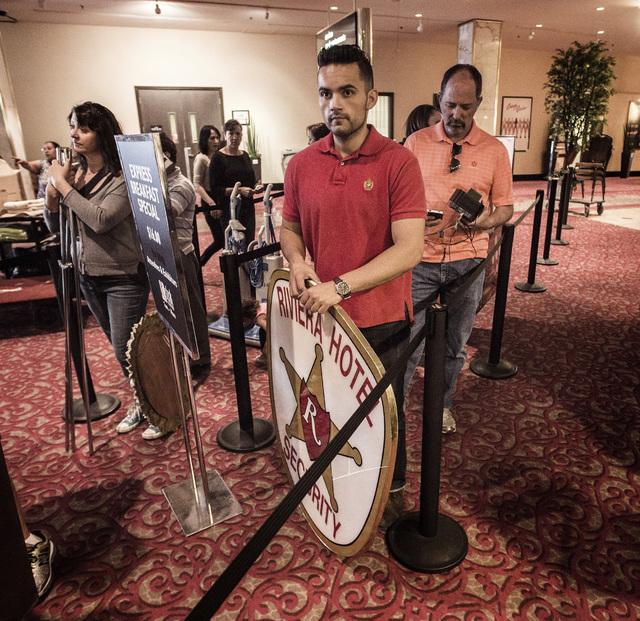 Former Riviera employee stands in line to purchase a sign  during the liquidation sale at the closed Riviera hotel-casino, 2901 South Las Vegas Boulevard Wednesday, May 13, 2015. Former employees  ...