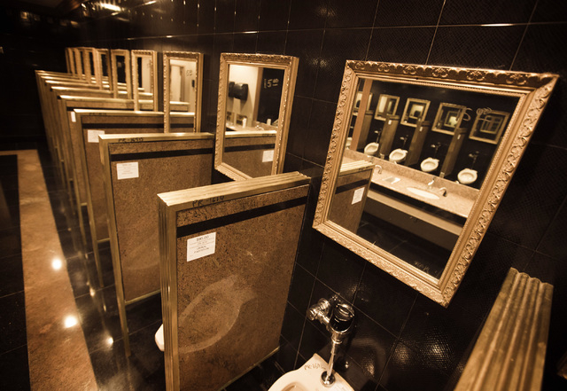 Urinal partitions on sale during the liquidation sale Wednesday, May 13, 2015 at the closed Riviera hotel-casino, 2901 South Las Vegas Boulevard. Former employees were able to purchase merchandise ...