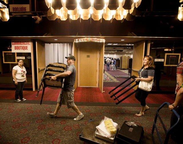 People carry items during the liquidation sale at the closed Riviera hotel-casino, 2901 South Las Vegas Boulevard Wednesday, May 13, 2015. Former employees were able to purchase merchandise early. ...