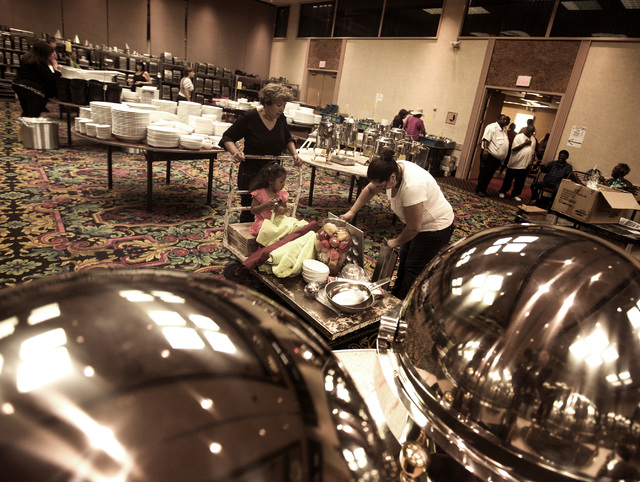 Former housekeeper Maryra Perez, left, her grand daughter Elyssa Evans, 2, and her daughter Elida Perez with cart full of items during the liquidation sale at the closed Riviera hotel-casino, 2901 ...