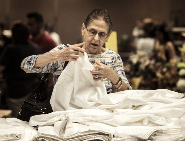 Former employee Shirley G., declined to give last name, looks a bed sheets during the liquidation sale at the closed Riviera hotel-casino, 2901 South Las Vegas Boulevard Wednesday, May 13, 2015. F ...