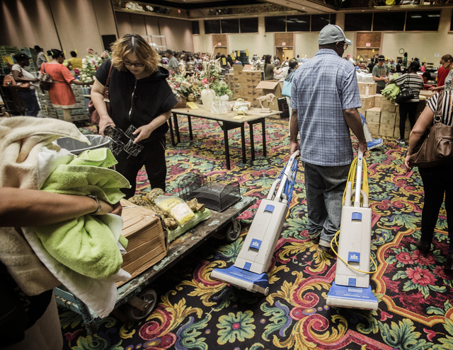 People stand in line to purchase items  during the liquidation sale at the closed Riviera hotel-casino,2901 South Las Vegas Boulevard, on Wednesday, May 13, 2015. Former employees were able to pur ...