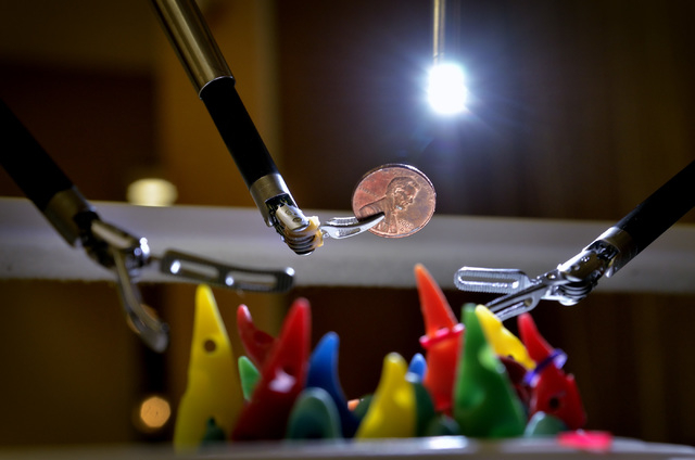 A penny is shown being lifted by one of the tools used by the da Vinci Xi robotic surgical system at Mountain View Medical Center at 3100 N. Tenaya Way in Las Vegas on Saturday, April 18, 2015. Me ...