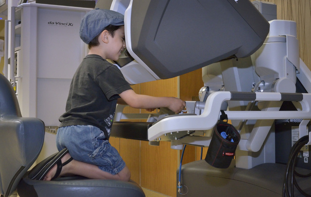 Leonardo Gutierrez, 5, sits at the surgical console of the da Vinci Xi robotic surgical system at Mountain View Medical Center at 3100 N. Tenaya Way in Las Vegas on Saturday, April 18, 2015. Membe ...