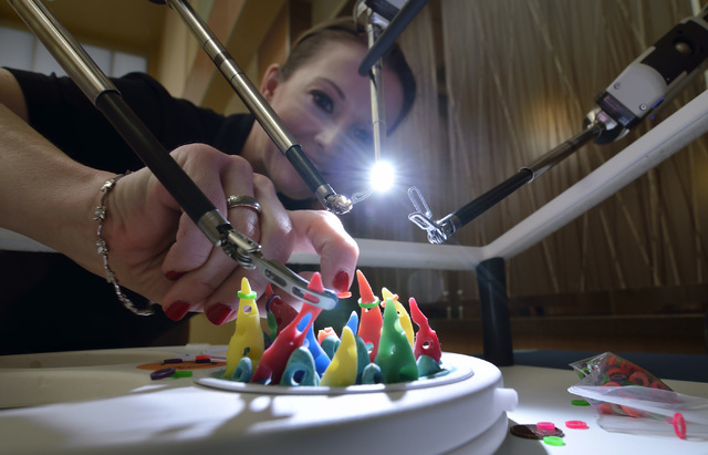 Jennifer McDonnell, vice president of marketing for Mountain View Medical Center, resets practice targets for the da Vinci Xi robotic surgical system during a health fair at the hospital at 3100 N ...