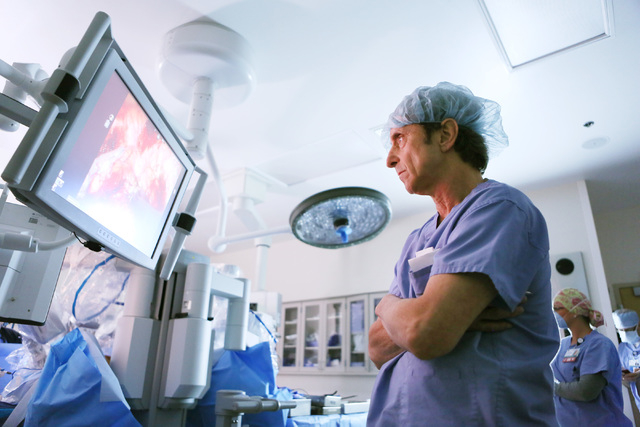 Dr. Scott Slavis, a urologic surgeon at Cleveland Clinic, watches a live video of a robotic bladder reconstruction procedure on a cancer patient at Sunrise Hospital & Medical Center Tuesday, April ...