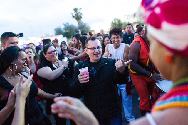 Elmer Rodriguez, center, dances with street performers during the Rock in Rio music festival in Las Vegas on Friday, May 8, 2015. (Chase Stevens/Las Vegas Review-Journal) Follow Chase Stevens on T ...