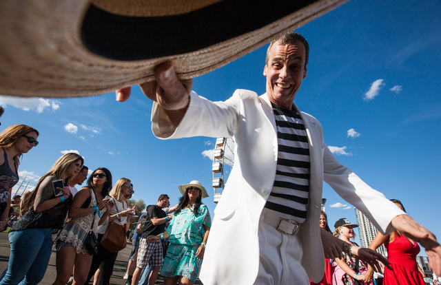 Carlinhos de Jesus leads a line dance during the Rock in Rio USA music festival in Las Vegas on Saturday, May 16, 2015. (Chase Stevens/Las Vegas Review-Journal) Follow Chase Stevens on Twitter @cs ...