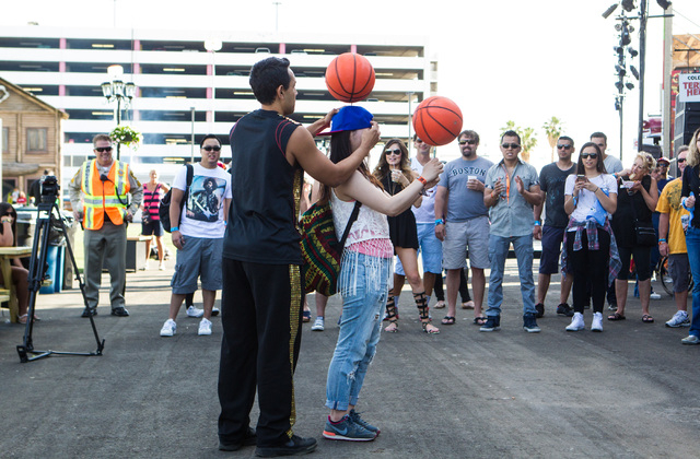Kalani Ahmad, left, performs a trick with the help of audience member Yu Sawada during the Rock in Rio USA music festival in Las Vegas on Saturday, May 16, 2015. (Chase Stevens/Las Vegas Review-Jo ...
