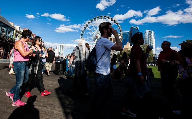 Attendees walk the festival grounds during the Rock in Rio USA music festival in Las Vegas on Saturday, May 16, 2015. (Chase Stevens/Las Vegas Review-Journal) Follow Chase Stevens on Twitter @csst ...