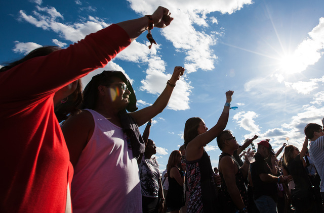 Attendees raise their fists in the air as Mayer Hawthorne performs at the Mercedes-Benz Evolution stage during the Rock in Rio USA music festival in Las Vegas on Saturday, May 16, 2015. (Chase Ste ...