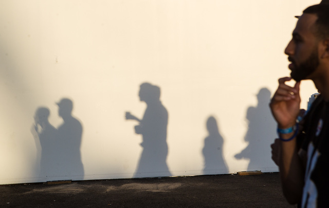 Shadows are cast against a wall as attendees walk the festival grounds during the Rock in Rio USA music festival in Las Vegas on Saturday, May 16, 2015. (Chase Stevens/Las Vegas Review-Journal) Fo ...