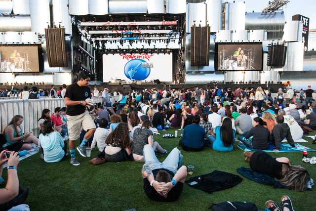 Attendees relax at the main stage before Empire of the Sun performs during the Rock in Rio USA music festival in Las Vegas on Saturday, May 16, 2015. (Chase Stevens/Las Vegas Review-Journal) Follo ...