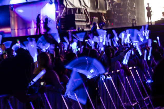 Fans wave light sticks before John Legend performs on the main stage during the Rock in Rio USA music festival in Las Vegas on Saturday, May 16, 2015. (Chase Stevens/Las Vegas Review-Journal) Foll ...