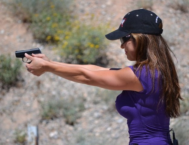 Kim Smith is seen target shooting in this undated photo. She said she carries a gun all the time. (Special to View)
