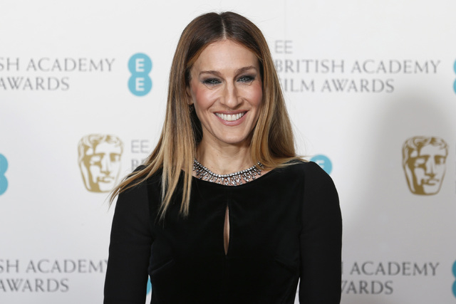 Sarah Jessica Parker poses for photographers at the British Academy of Film and Arts (BAFTA) awards ceremony at the Royal Opera House in London February 10, 2013. (Suzanne Plunkett/Reuters)