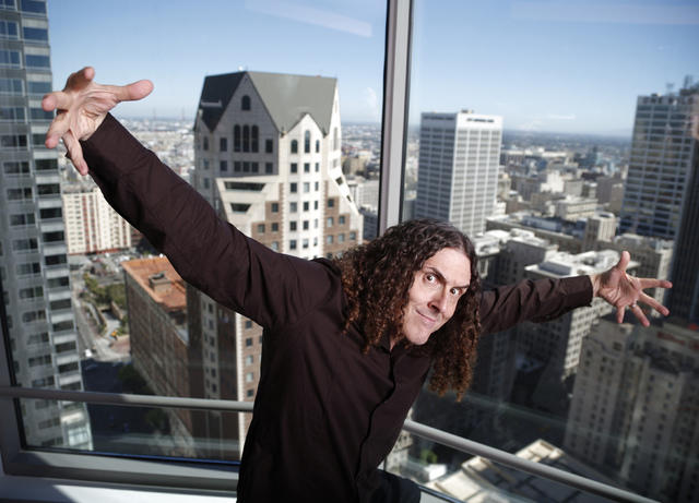 """Musician """"Weird Al"""" Yankovic poses for a portrait in the Reuters bureau in Los Angeles, California July 24, 2014. The 54-year-old singer of such songs as """"Eat It,"""" a culinary spoof on Michael Jack ..."""