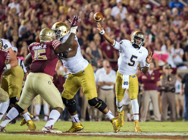 Oct 18, 2014; Tallahassee, FL, USA; Notre Dame Fighting Irish quarterback Everett Golson (5) throws in the first quarter against the Florida State Seminoles at Doak Campbell Stadium. Mandatory Cre ...