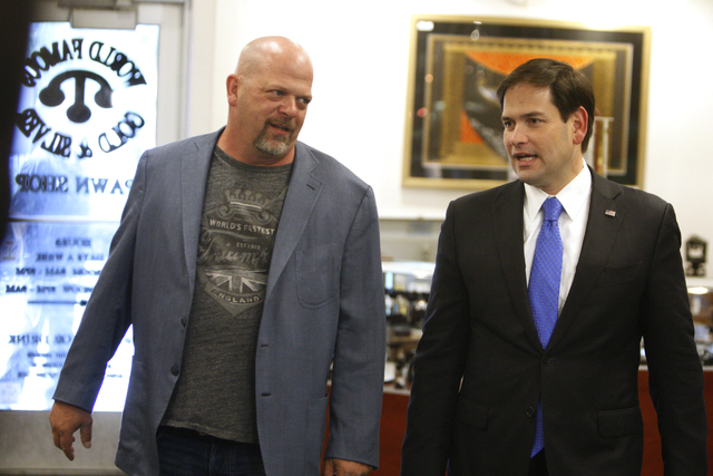 Rick Harrison, left, co-owner of World Famous Gold & Silver Pawn Shop, gives a tour to Republican presidential candidate U.S. Sen. Marco Rubio, R-Fla., at the World Famous Gold & Silver Pawn Shop  ...