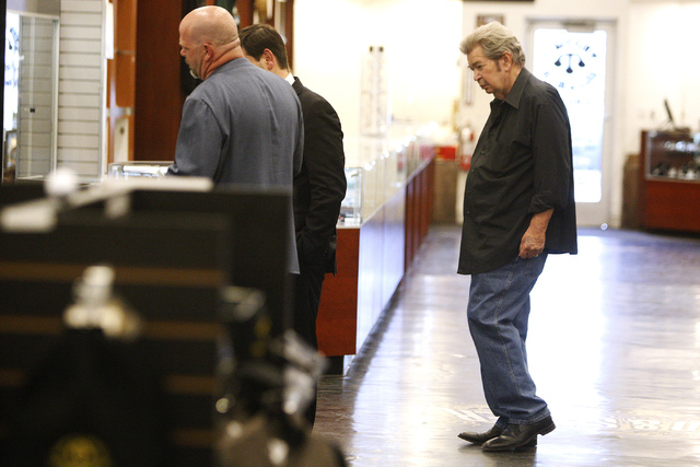 Richard Harrison, right, co-owner of the World Famous Gold & Silver Pawn Shop, looks on as his son Rick give a tour to Republican presidential candidate U.S. Sen. Marco Rubio,  R-Fla., at the Worl ...