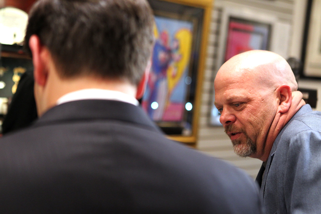 Rick Harrison, right, co-owner of the World Famous Gold & Silver Pawn Shop, gives a tour to Republican presidential candidate U.S. Sen. Marco Rubio, R-Fla., at the World Famous Gold & Silver Pawn  ...