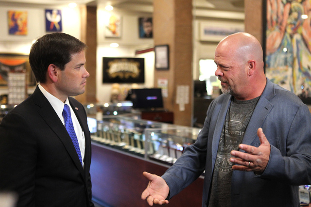 Republican presidential candidate U.S. Sen. Marco Rubio, R-Fla., left, tours the World Famous Gold & Silver Pawn Shop in Las Vegas with shop co-owner Rick Harrison on Thursday, May 28, 2015. (Erik ...