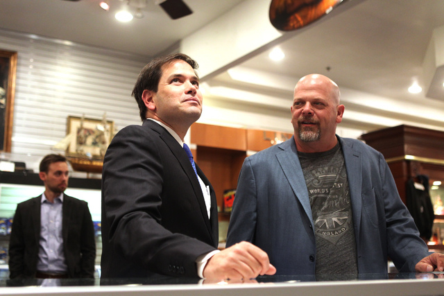 Republican presidential candidate U.S. Sen. Marco Rubio, R-Fla., left, tours the World Famous Gold & Silver Pawn Shop in Las Vegas with shop owner Rick Harrison on Thursday, May 28, 2015. (Erik Ve ...