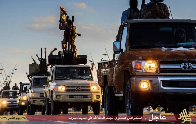 ISIS released still pictures purporting to show massive parade of their militants in the city of Sirte, Libya  (CNN)