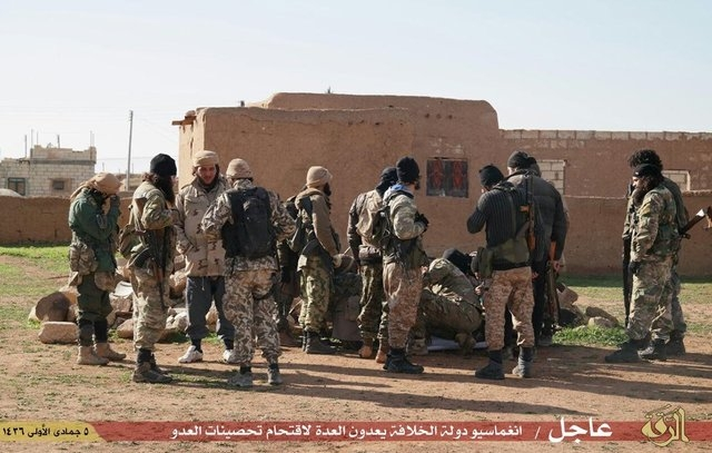 ISIS released propaganda photos show its militants attacking  Tal Tamer town in  al-Hasaka about 640 km northeast of Damascus , where  Kurdish fighters  are battling ISIS. Please note that ISIS  c ...
