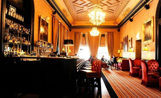 With its Baccarat chandeliers, antique fireplace, damask walls and Chesterfield armchairs, The Bar in The Merchant Hotel in Belfast is one undoubtedly classy establishment. (The Merchant Hotel/CNN)