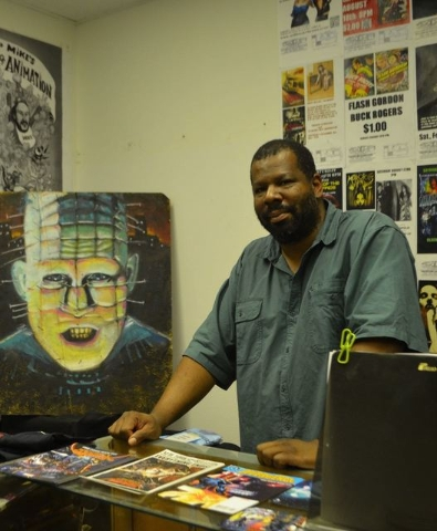 William Powell stands behind the counter at The Sci Fi Center. (Ginger Meurer/Special to View)