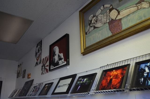 Artwork is displayed on a rack and on the wall at The Sci Fi Center. (Ginger Meurer/Special to View)
