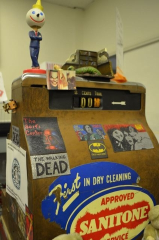 A vintage cash register adorned with stickers and other memorabilia is seen at The Sci Fi Center. (Ginger Meurer/Special to View)