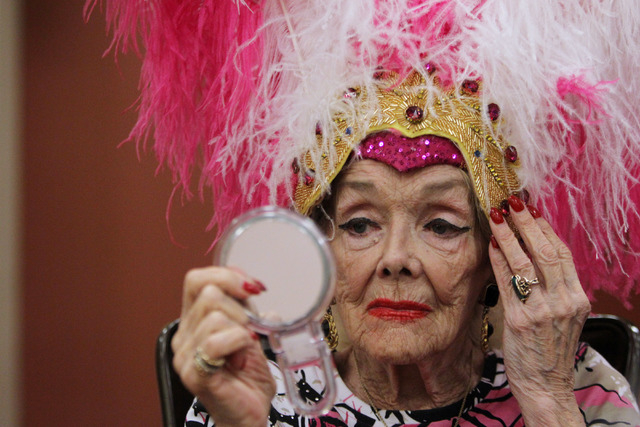 Former showgirl Gloria White adjusts her headdress during a bingo session at the Fiesta Rancho Wednesday, April 22, 2015. (Sam Morris/Las Vegas Review-Journal) Follow Sam Morris on Twitter @sammor ...