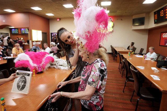 Former showgirls Julie Language, left, and Gloria White put their headdresses on before a bingo session at the Fiesta Rancho Wednesday, April 22, 2015. (Sam Morris/Las Vegas Review-Journal) Follow ...