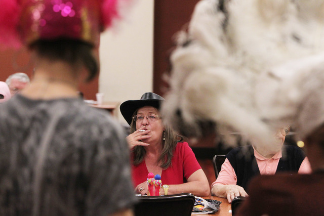 A bingo patron watches as former showgirls get ready for a bingo session at the Fiesta Rancho Wednesday, April 22, 2015. (Sam Morris/Las Vegas Review-Journal) Follow Sam Morris on Twitter @sammorrisRJ