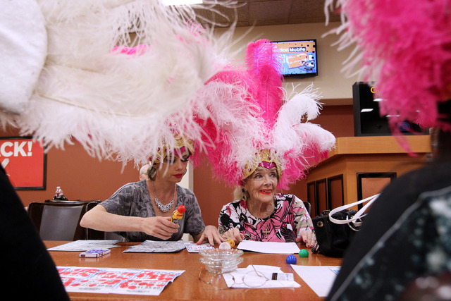 Former showgirl Julie Language, left, helps Gloria White during a bingo session at the Fiesta Rancho Wednesday, April 22, 2015. (Sam Morris/Las Vegas Review-Journal) Follow Sam Morris on Twitter @ ...