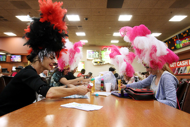 Former showgirls Troy Stern, left, and Mallory Huck play with other showgirls during a bingo session at the Fiesta Rancho Wednesday, April 22, 2015. (Sam Morris/Las Vegas Review-Journal) Follow Sa ...