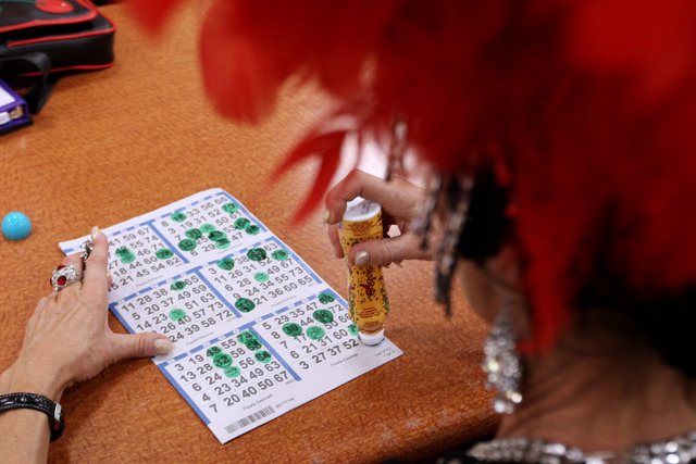 Former showgirl Troy Stern daubs a card during a bingo session at the Fiesta Rancho Wednesday, April 22, 2015. (Sam Morris/Las Vegas Review-Journal) Follow Sam Morris on Twitter @sammorrisRJ
