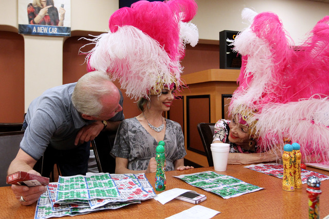 Former showgirl Gloria White, right, talks to an admirer after a bingo session at the Fiesta Rancho Wednesday, April 22, 2015. (Sam Morris/Las Vegas Review-Journal) Follow Sam Morris on Twitter @s ...