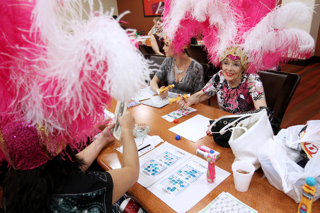 Former showgirls, including Gloria White, right, take part in  a bingo session at the Fiesta Rancho Wednesday, April 22, 2015. (Sam Morris/Las Vegas Review-Journal) Follow Sam Morris on Twitter @s ...