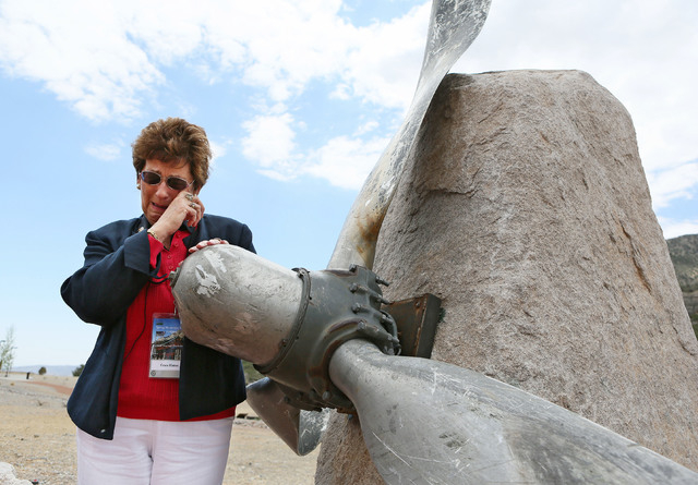 "Grace Hatton, of Long Island, New York, is overcome with emotion while speaking about her brother Terence ""Terry"" O'Donnell while standing at the propeller from USAF 9068 at the entrance ..."