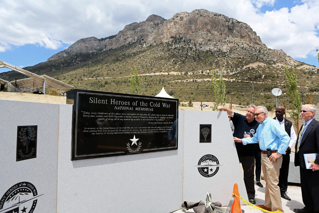 Steve Ririe, left, Silent Heroes of the Cold War committee chair, and U.S. Sen. Harry Reid, D-Nev., look at the Silent Heroes of the Cold War national memorial at Spring Mountains Visitor Gateway  ...
