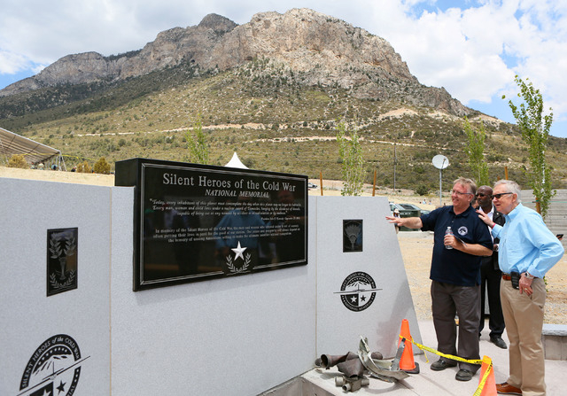 Steve Ririe, left, Silent Heroes of the Cold War committee chair, and U.S. Sen. Harry Reid, D-Nev., right, look at the Silent Heroes of the Cold War national memorial at Spring Mountains Visitor G ...