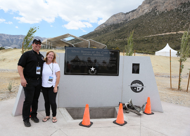 Doug Yates, left, an dhis wife Jodi stand for a personal photograph at the Silent Heroes of the Cold War national memorial at Spring Mountains Visitor Gateway Friday, May 30, 2015, in Kyle Canyon  ...