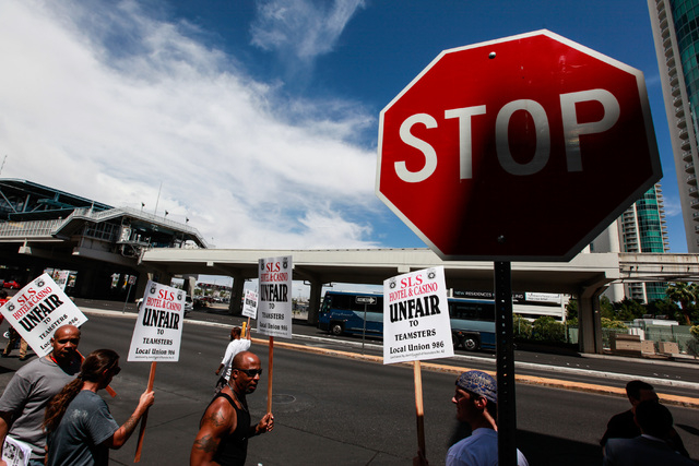 People with Teamsters Local 986 protest outside of the SLS hotel-casino by the Paradise Road entrance  in Las Vegas on Wednesday, May 20, 2015. The Teamsters Union is complaining that the hotel-ca ...