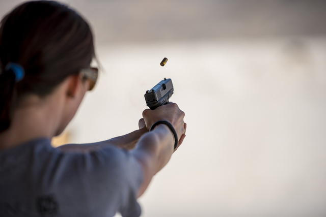 Shayne Smit fires a shot down range at the Clark County Shooting Complex, 11357 N. Decatur Blvd., May 17, 2015. More women are buying guns, according to a new survey. The shooting complex rents ou ...