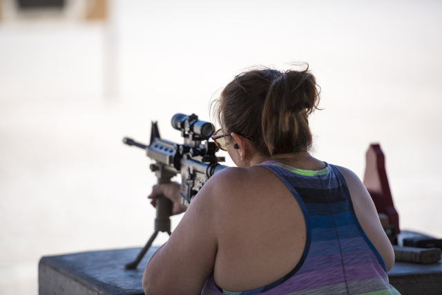 Michele Lowe fires a rifle at the Clark County Shooting Complex,  11357 N. Decatur Blvd., May 17, 2015. More women are buying guns, according to a new survey, and workers at the shooting range sai ...