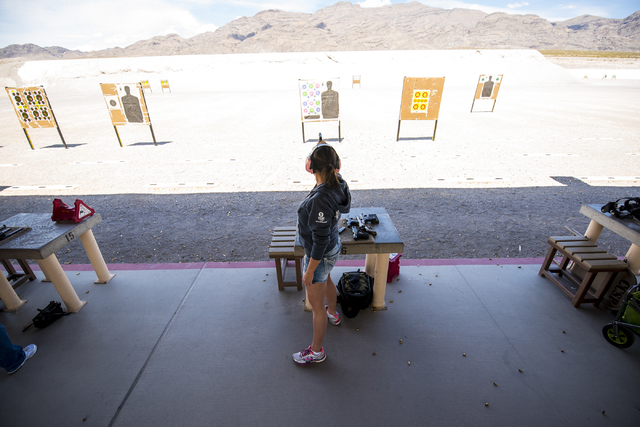 Dana Dwiggins takes shots with a handgun at the Clark County Shooting Complex May 17, 2015. (Joshua Dahl/View)